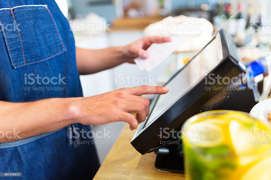 Barista using cash counter stock photo