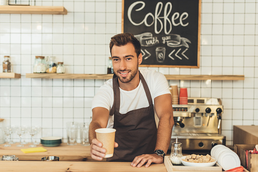 barista with coffee to go