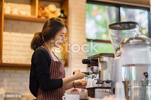 barista woman making latte art at coffee shop,equipment, coffee shop,cafeteria people and technology concept