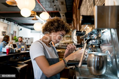 istock Barista working at a cafe 654089466