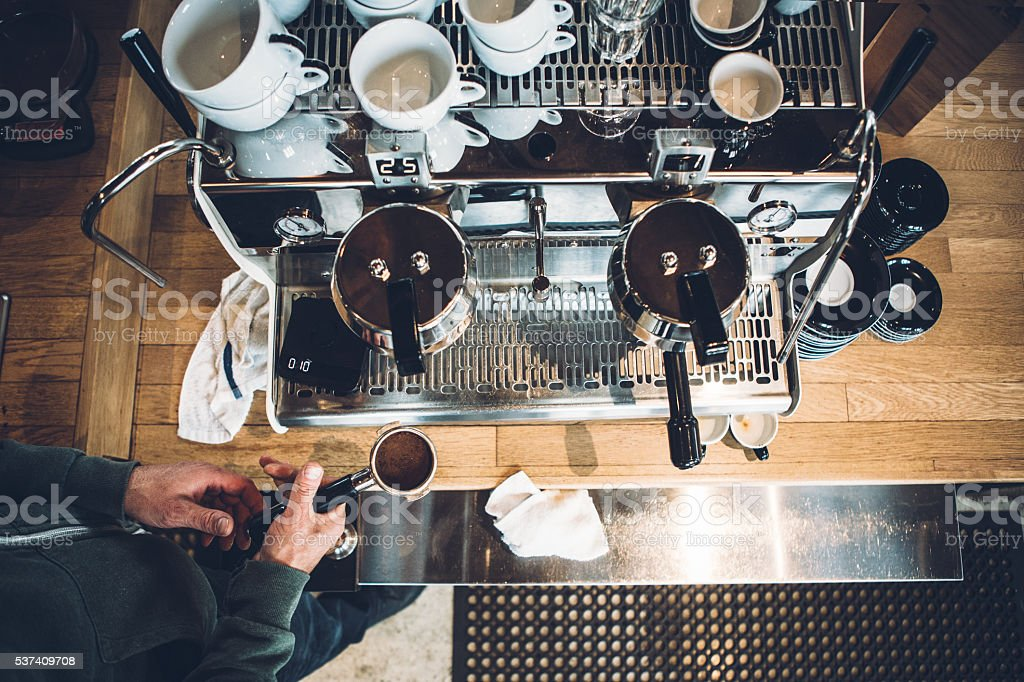Barista Working on Espresso Machine stock photo