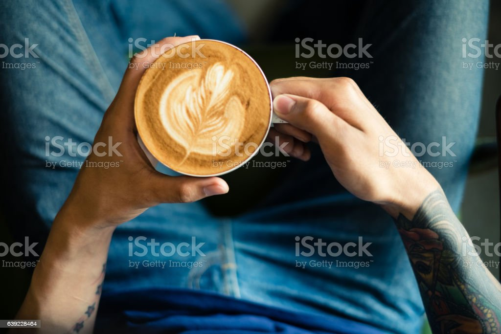 Baristas are coffee,by tattooed barista arm stock photo