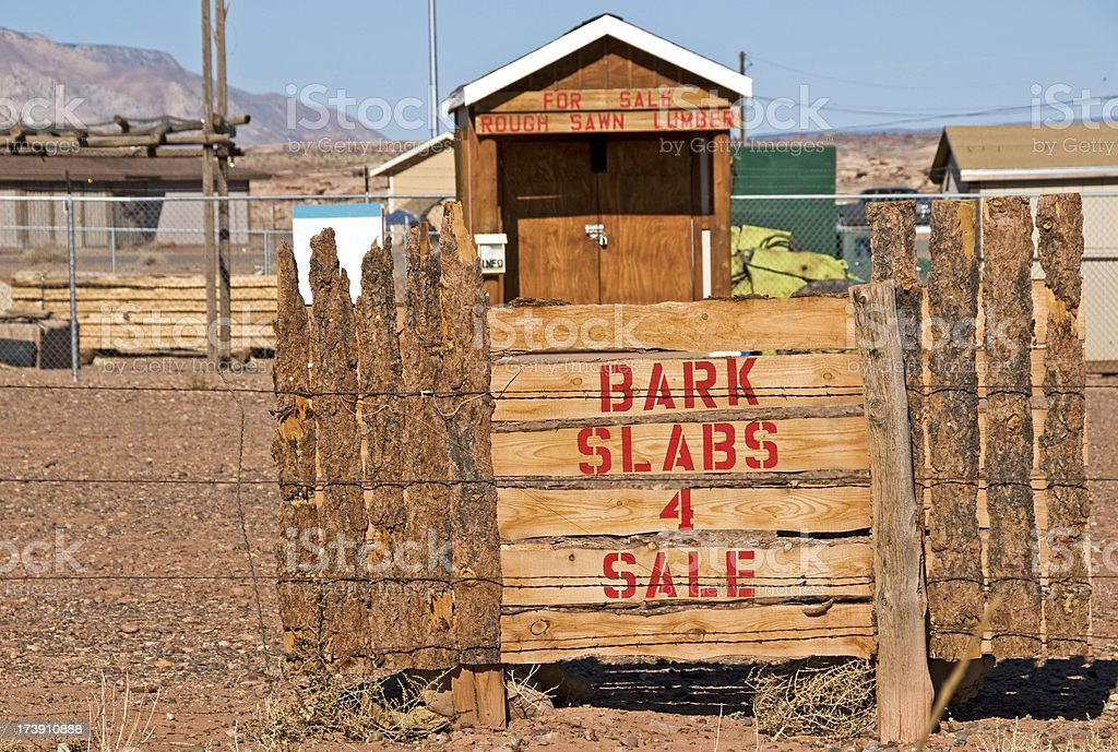 Bark slabs for sale sign royalty-free stock photo