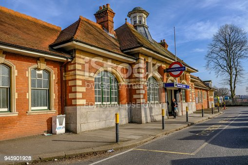 Barkingside, Ilford, Essex, UK - April 6, 2018: Exterior view of Barkingside Underground station with a passenger leaving from the entrance.