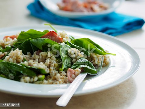 Healthy home made barley spinach salad,add chopped bacon and roasted pine nuts.Healthy home made barley spinach salad,add chopped bacon and roasted pine nuts.