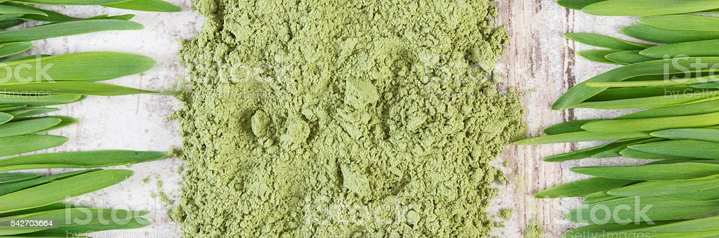 Barley grass and heap of young powder barley, body detox stock photo