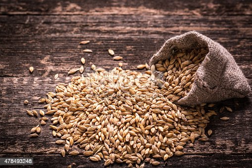 istock Barley on wooden table 478493248