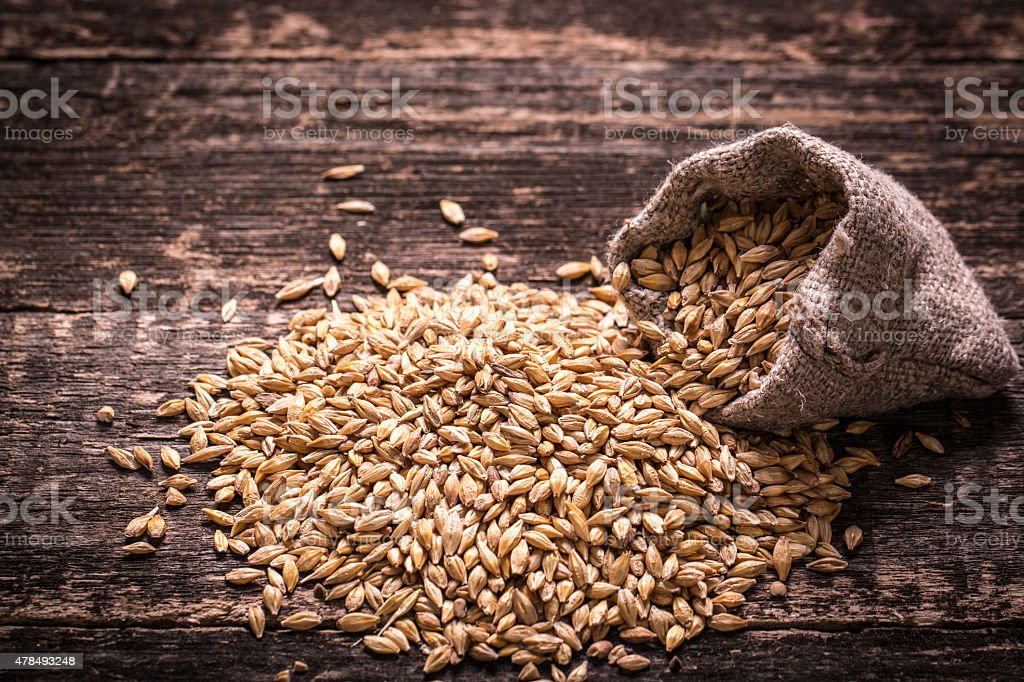 Barley on wooden table stock photo