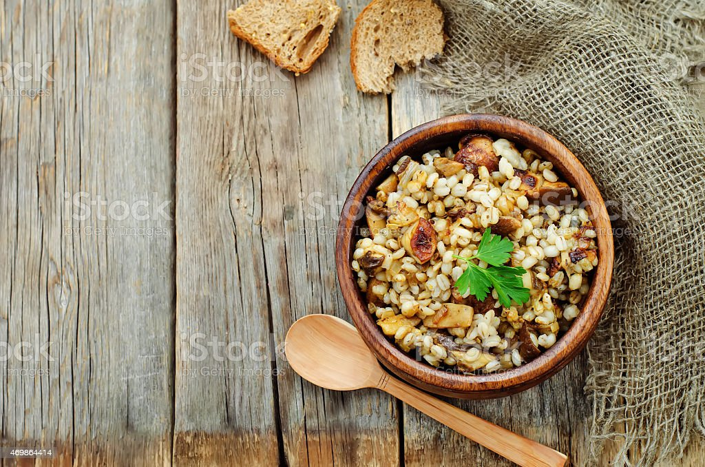 barley porridge with mushrooms stock photo