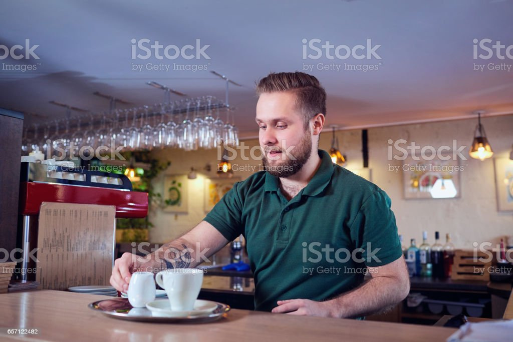 Barman barista  making coffee tea cocktails in the bar, restaura stock photo