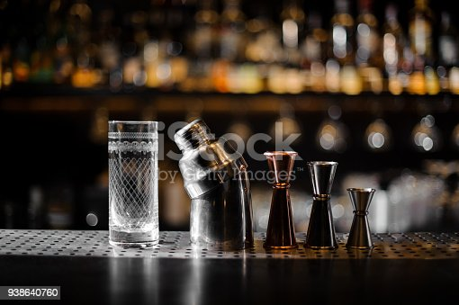 1013514594 istock photo Barman essentials on a blurred background of bar 938640760
