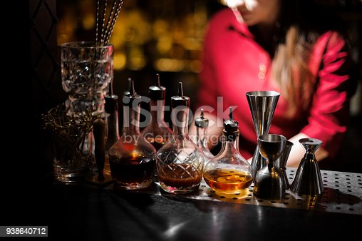 1013514594istockphoto Barman essentials on the blurred background of female barthender 938640712