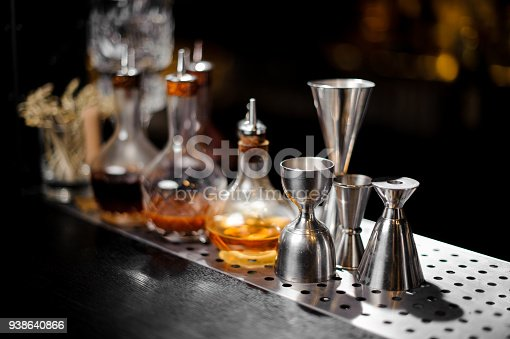 1013514594 istock photo Barman essentials standing at the steel bar counter 938640866