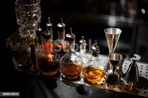 1013514594 istock photo Barman essentials standing on the steel bar counter 938640644