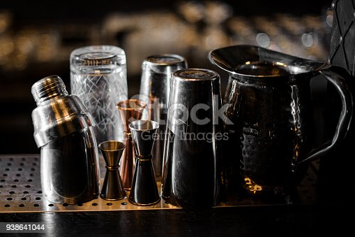 1013514594 istock photo Barman essentials standing on the steel bar counter 938641044