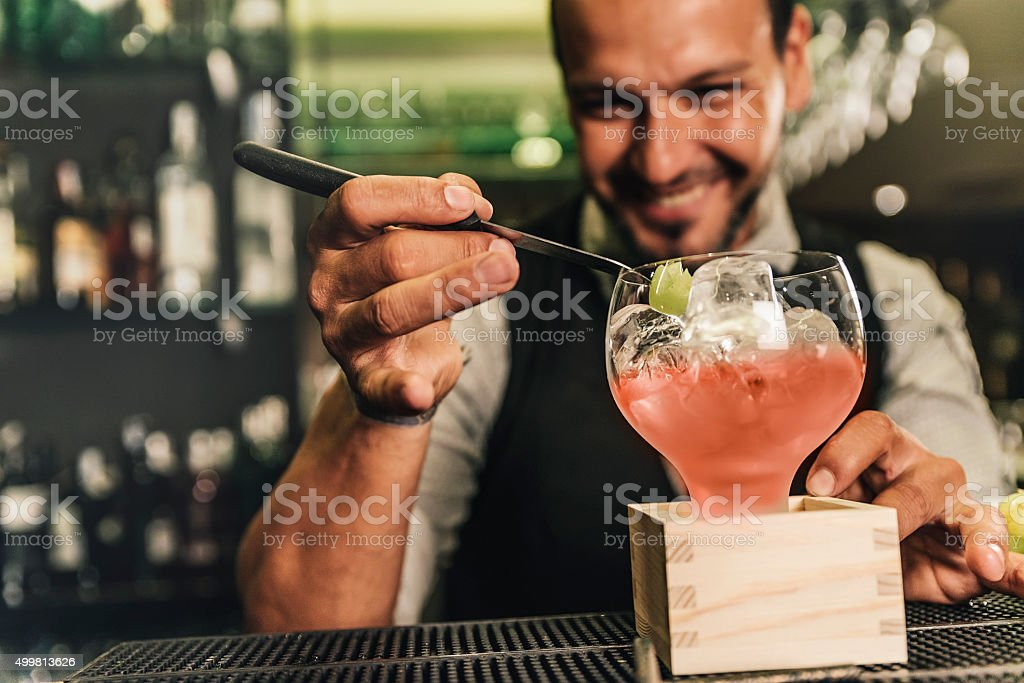 Barman is making cocktail at night club stock photo