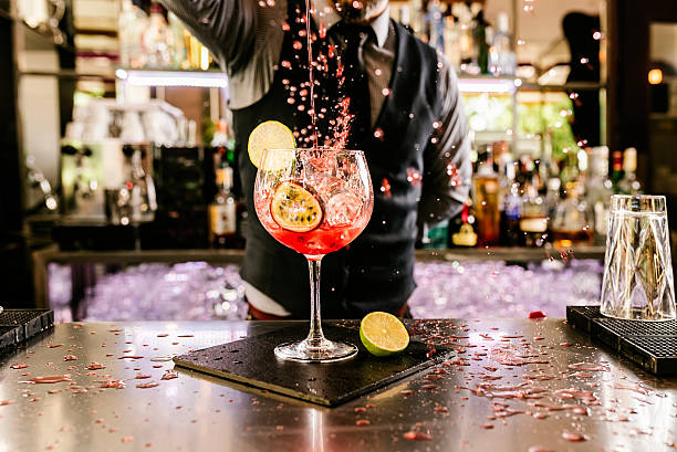 Barman is making cocktail at night club. Expert barman is making cocktail at night club. bartender stock pictures, royalty-free photos & images