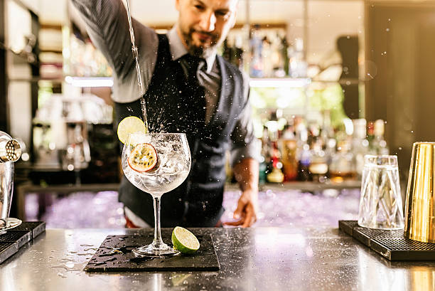barman is making cocktail at night club. - happy hour stock photos and pictures