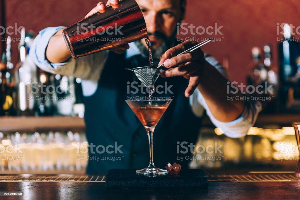 Barman is making cocktail at night club. royalty-free stock photo