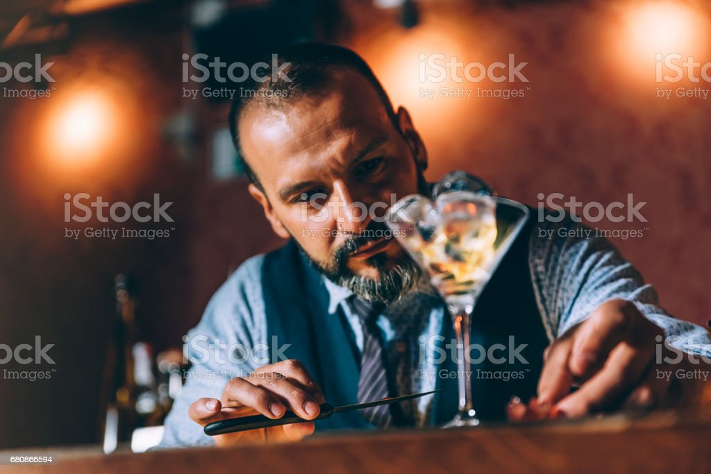 Barman is making cocktail at night club. royalty-free stock photo