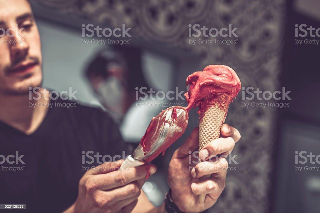 Barman is serving ice cream stock photo