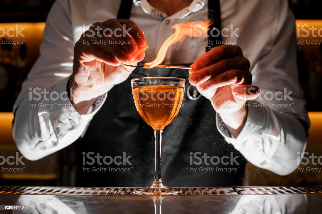 Barman making a fresh alcoholic drink with a smoky note stock photo