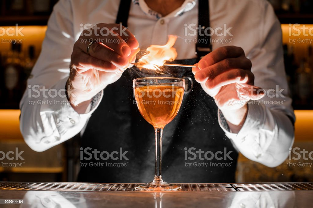 Barman making a fresh cocktail with a smoky note stock photo