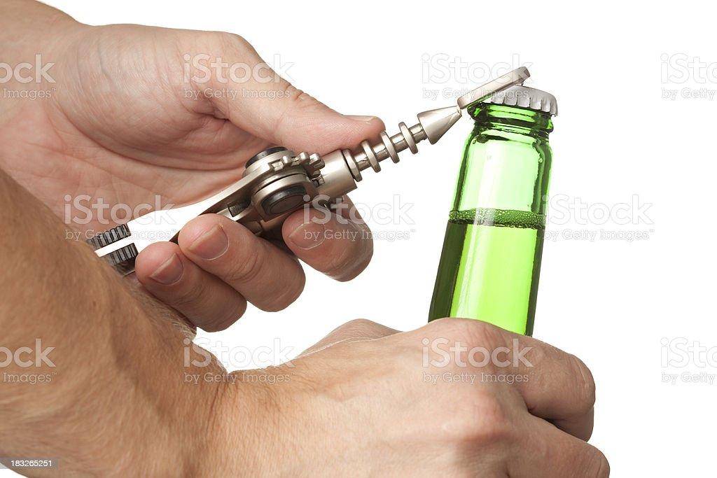 Barman opening Beer Bottle. stock photo