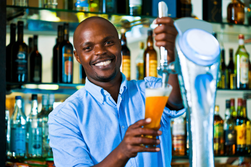 Barman Pouring Beer Stock Photo - Download Image Now