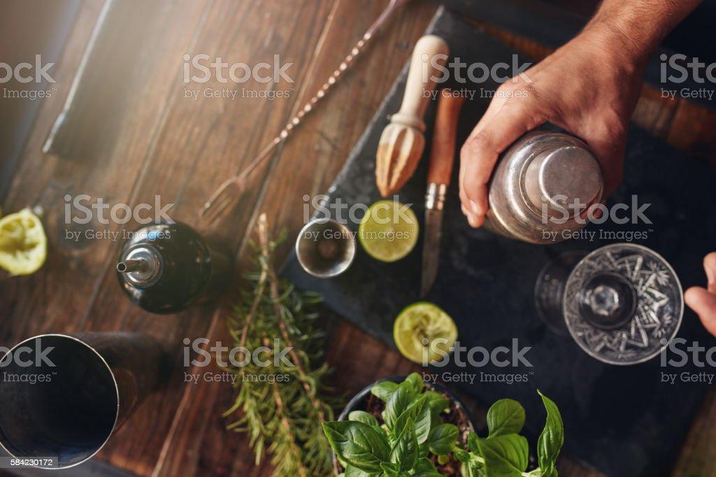 Barman preparing cocktail in shaker royalty-free stock photo