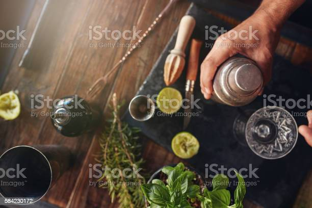 Barman preparing cocktail in shaker picture id584230172?b=1&k=6&m=584230172&s=612x612&h=ovbvvvgbxkpxt j dxpb3ilgbx9cxmzkphuoufb sgo=