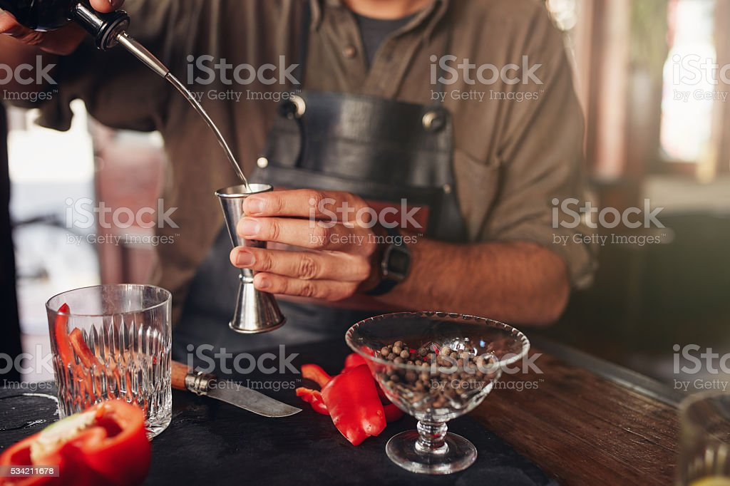 Barman preparing exotic cocktail stock photo