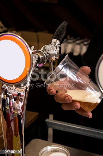 istock barman serving a cold beer 1067452490