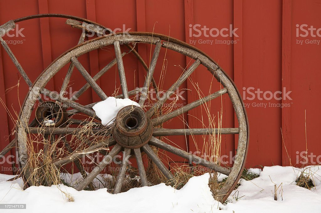 Barn and Wagon Wheels royalty-free stock photo
