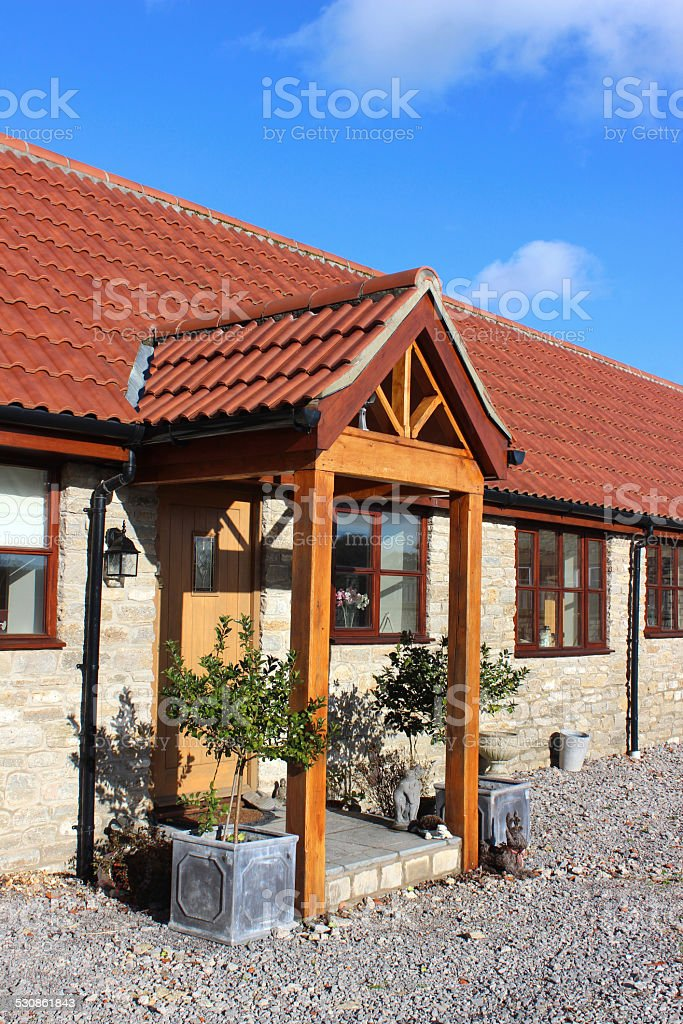 Barn conversion house / bungalow, converted-stables / outbuildings, timber, open porch stock photo