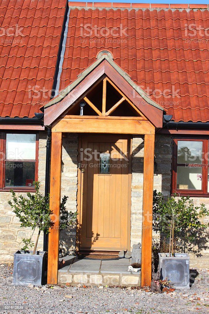 Barn conversion house / bungalow, converted-stables / outbuildings, wooden porch (open-porch) stock photo