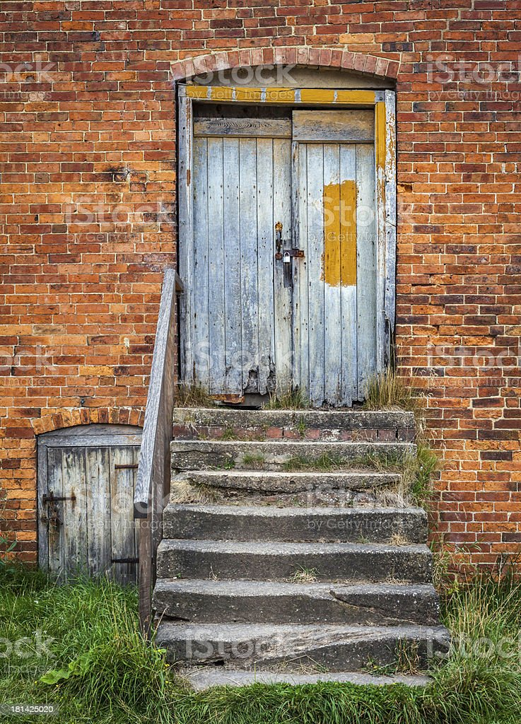 Barn Door with stone steps royalty-free stock photo