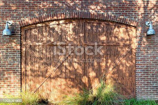 pair of barn doors on a brick barn farm building