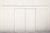 Double door entrance to large barn.