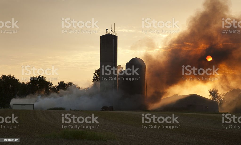 Barn Fire At Sunset stock photo
