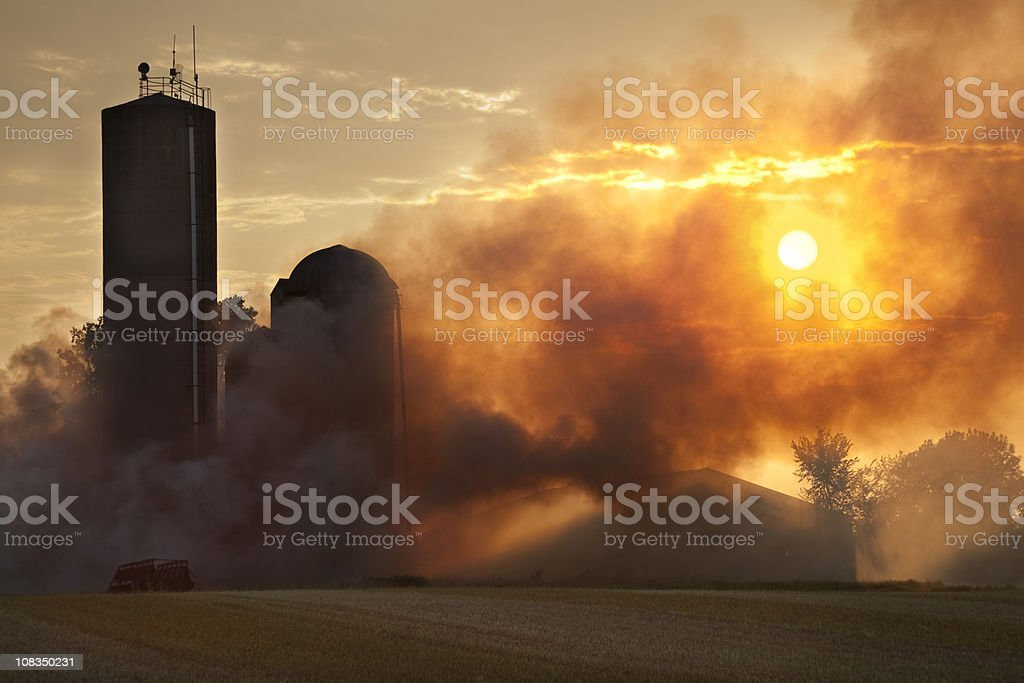 Barn Fire in the Light of Sunset stock photo