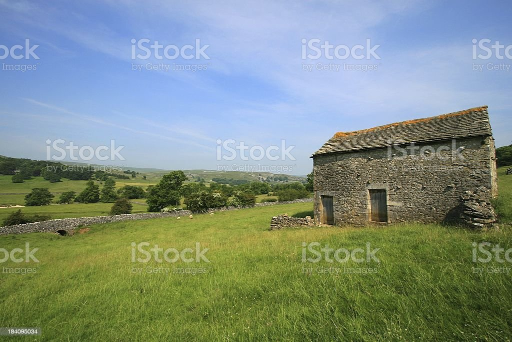 Barn in open valley royalty-free stock photo