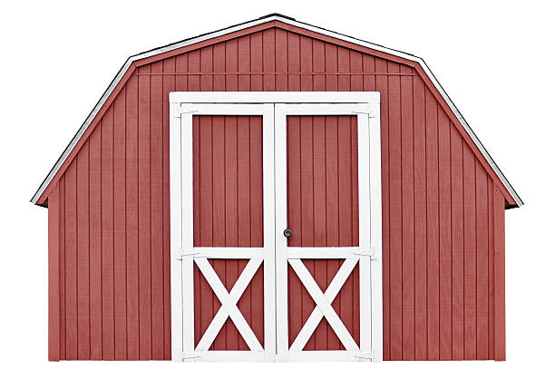 Barn style utility tool shed isolated on white background stock photo