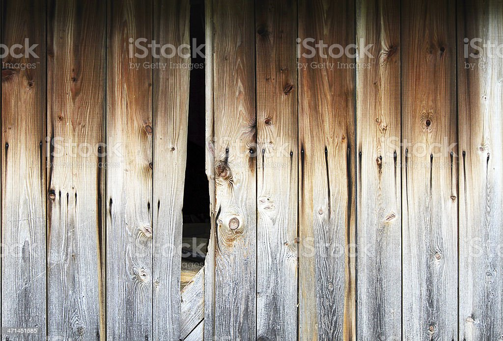 Barn walll with hole in it stock photo