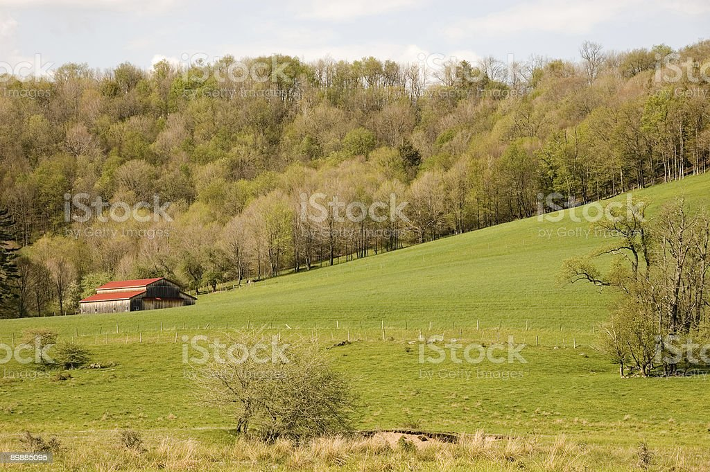 Barn with red roof in a spring setting royalty-free stock photo