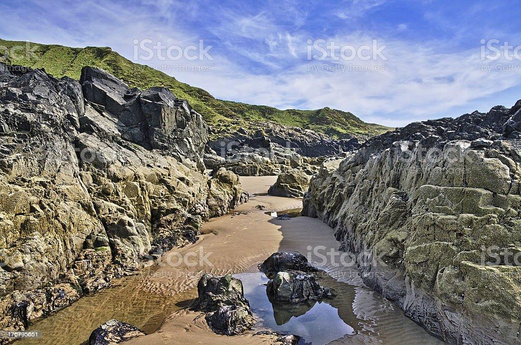 Barnacle encrusted rocks at Killantringan Bay stock photo