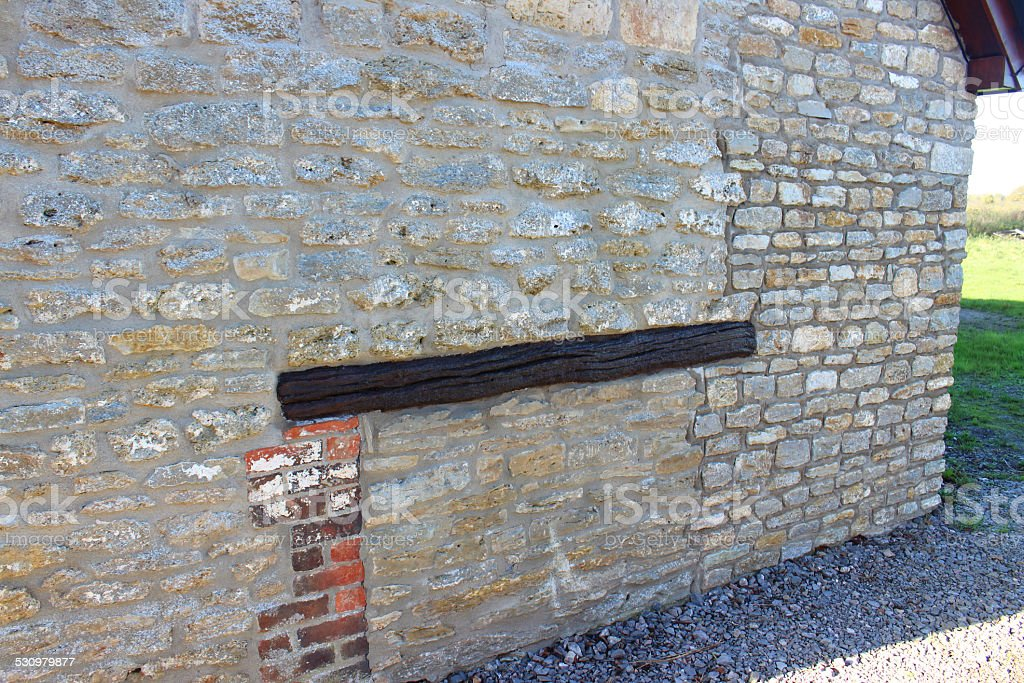 Barn-conversion house wall, re-pointed old bricks, new home-improvement extension, wooden-beam stock photo