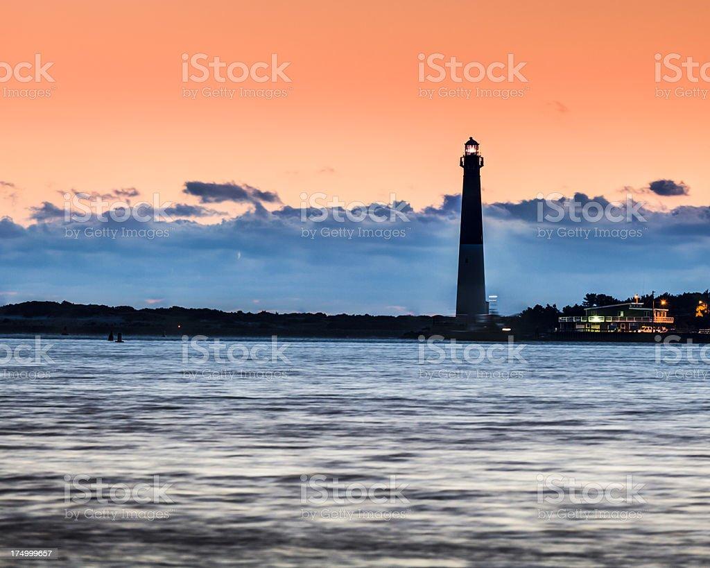 Barnegat Lighthouse at Dawn under Orange Sky royalty-free stock photo