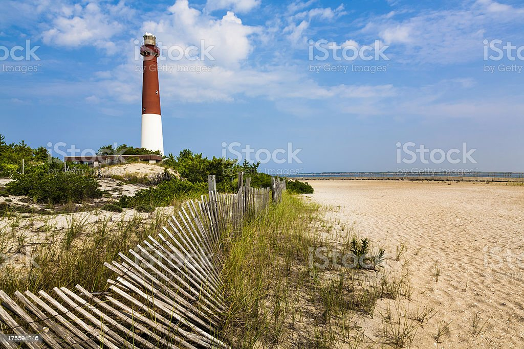 Barnegat Lighthouse, sand, beach, dune fence, New Jersey stock photo