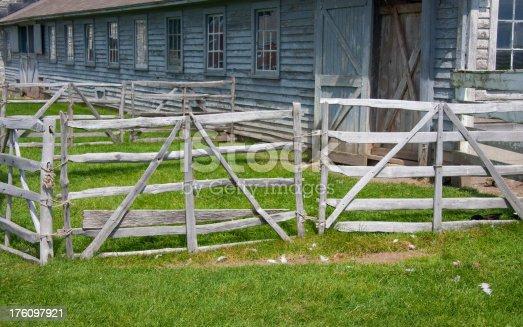 A gray barn and dairy barnyard at an old Shaker farm.
